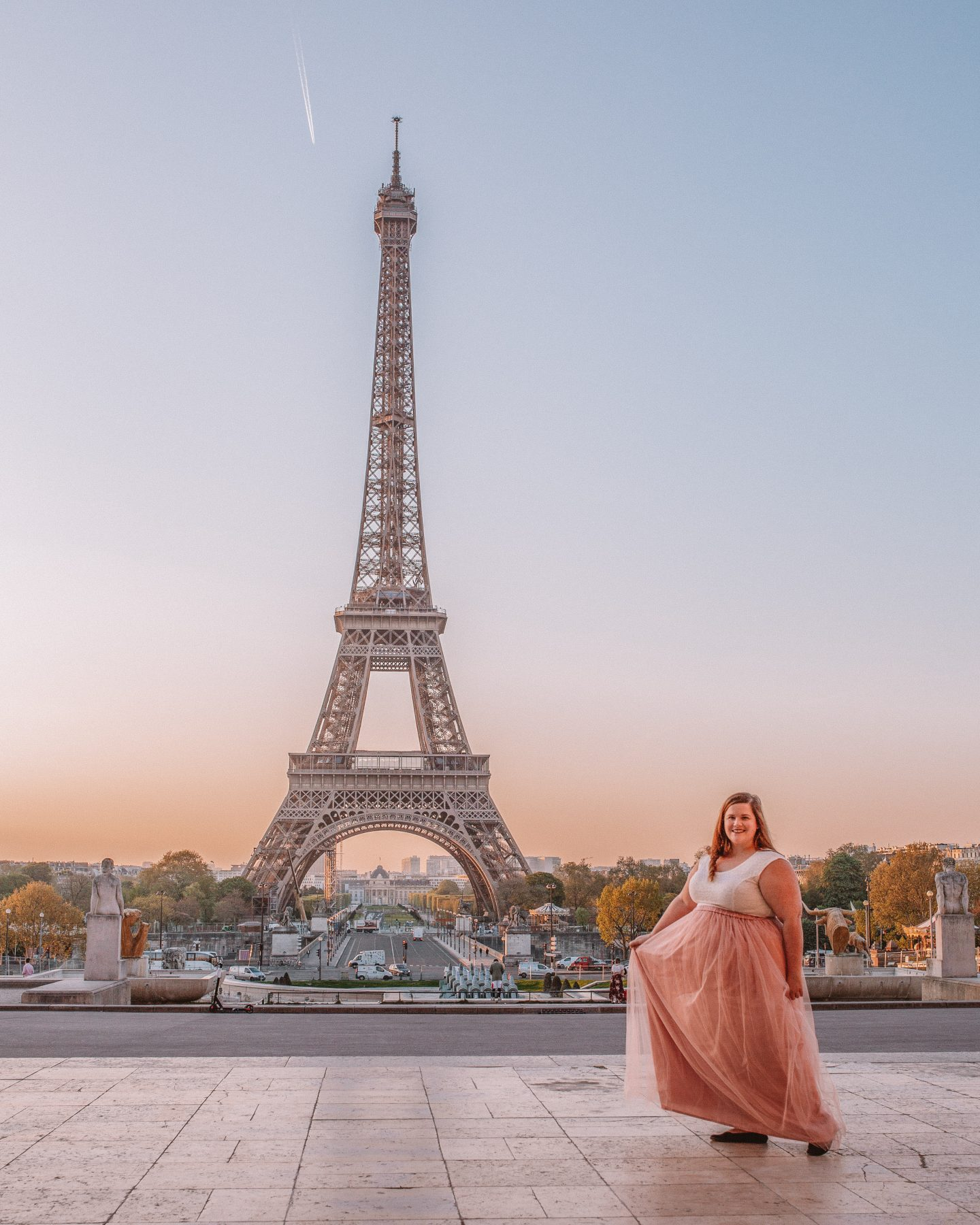 How to get incredible photos of yourself while traveling in Paris, France at the Eiffel Tower.