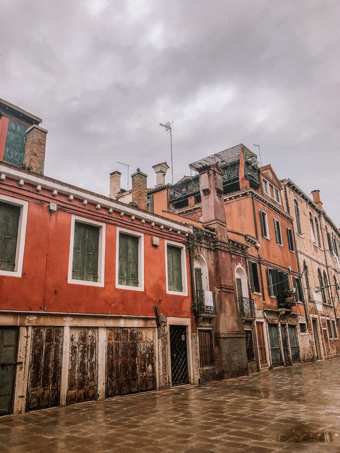 Buildings on a recently wet street in Venice, Italy