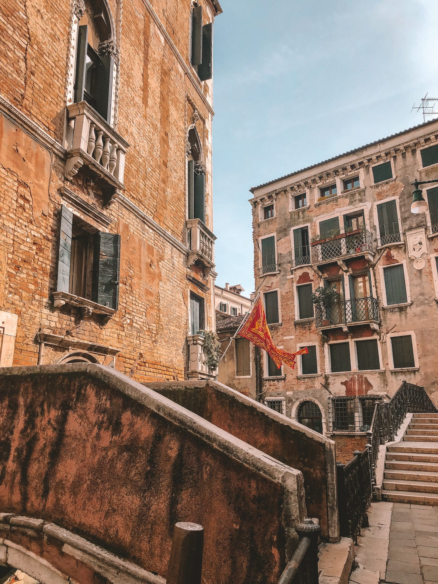 Large brick building with flag flapping out front in Venice, Italy